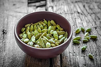 Bowl of cardamom pods